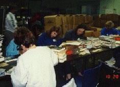 Library volunteers sorting books