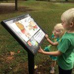 Kids reading storywalk panel