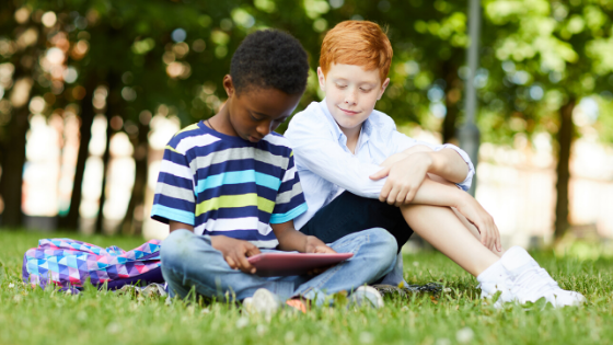 Two kids reading on tablet